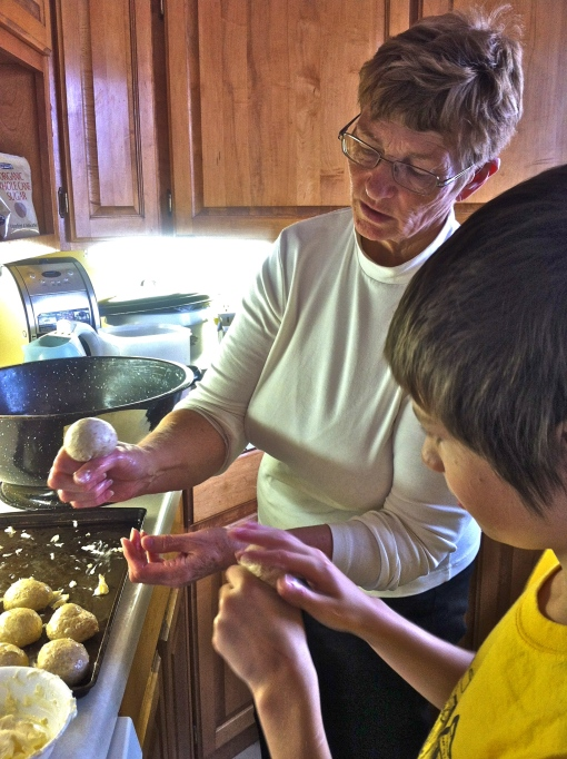 Grandma making buns with Carter