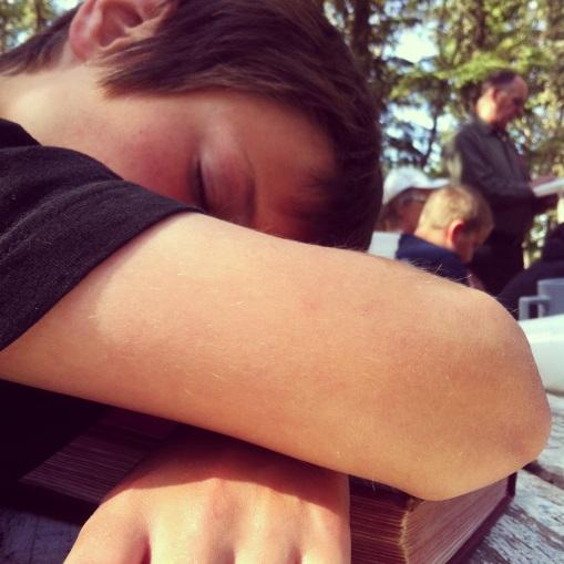 Carter sleeping through church at camp